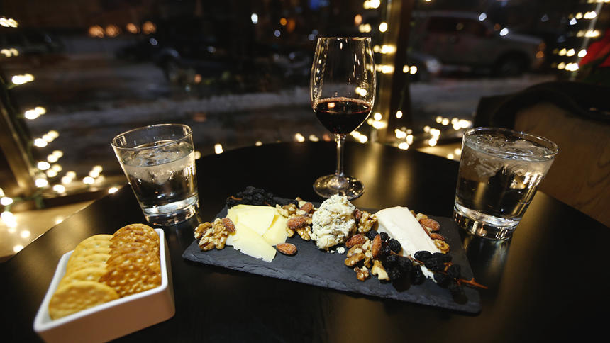 The Red Adventure cheese plate, Shelburne cheddar, Taleggio Invernizzi, Colston Bassett Stilton with garnishes of Mojave dessert raisins, walnuts and almonds.. Jesse Trelstad/ Grand Forks Herald